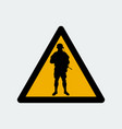 warning sign with soldier silhouette vector image vector image