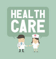 doctor and nurse with a balloon saying health care vector image