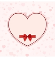 Paper heart with red ribbon and a bow vector image