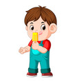 a boy eating fruit ice cream on a stick vector image vector image