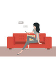 woman sitting on sofa with messaging vector image