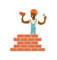 smiling worker building a brick wall colorful vector image