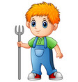 cartoon boy farmer holding rake vector image vector image