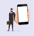 businessman character with smartphone in hand vector image