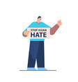 man holding banner against bullying and racism vector image vector image