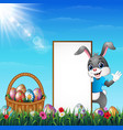 cartoon easter bunny with a basket of easter eggs vector image vector image