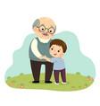 boy hugging his grandfather vector image