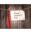 Happy Fathers Day background with a red tie on a vector image vector image