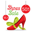 women high heel pump with green ribbon vector image