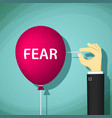 man bursts a balloon with the word fear vector image