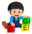 baby boy and alphabet blocks cartoon vector image vector image