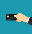 hand hold credit card icon payment concept vector image