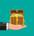 opened chest full treasures in hand vector image