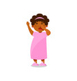 cute little girl in pink pajamas yawning vector image