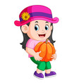cute child holding big pumpkin vector image