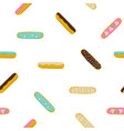 eclairs french pastry seamless pattern vector image vector image