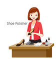 women polishing her shoes vector image