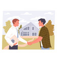 agent and man shake hands on a real estate