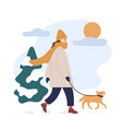 woman in warm clothes walking dog in snowy winter vector image vector image