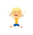 happy boy hanging on gymnastic rings kids vector image vector image
