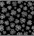 Seamless pattern with white clover on black