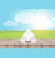 easter background with cute bunny on wooden table vector image vector image