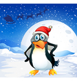 A penguin wearing Santas hat vector image vector image