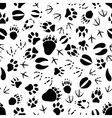 Black and white animal tracks pattern vector image