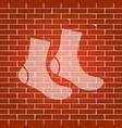 socks sign whitish icon on brick wall as vector image vector image