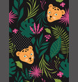 Seamless pattern wit leopards on a black backgroun