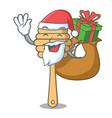 santa with gift honey spoon mascot cartoon vector image