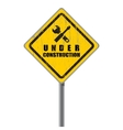 Old shabby road sign under construction vector image vector image