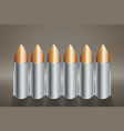 six rounds of a copper bullet stand in a row vector image