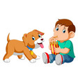 young boy eating french fries with a dog vector image vector image