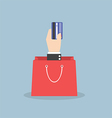 businessman hand holding credit card with shopping vector image