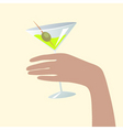 hand holding a martini glass vector image