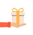 hand holding or offering gift with orange bow or vector image vector image