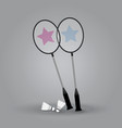 two badminton rackets with shuttlecock on gray vector image