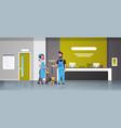 couple janitors man woman in uniform working vector image vector image