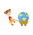 girl pulling earth planet in a cart vector image vector image