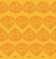 golden leaves pattern on a yellow background vector image