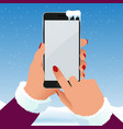 female hand is holding a phone outside in the vector image vector image