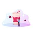 tiny male character decorating huge cup coffee vector image
