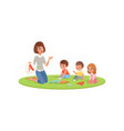 teacher and little kids sitting on soft carpet and vector image