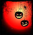 Halloween background - two pumpkins and cobweb vector image vector image