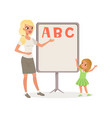 happy little girl and teacher standing next to vector image vector image