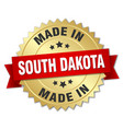 Made in south dakota gold badge with red ribbon