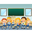 Students in uniform standing in classroom vector image vector image