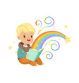 adorable little boy reading magic book with fairy vector image