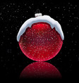 christmas red ball with snow cap on black vector image vector image
